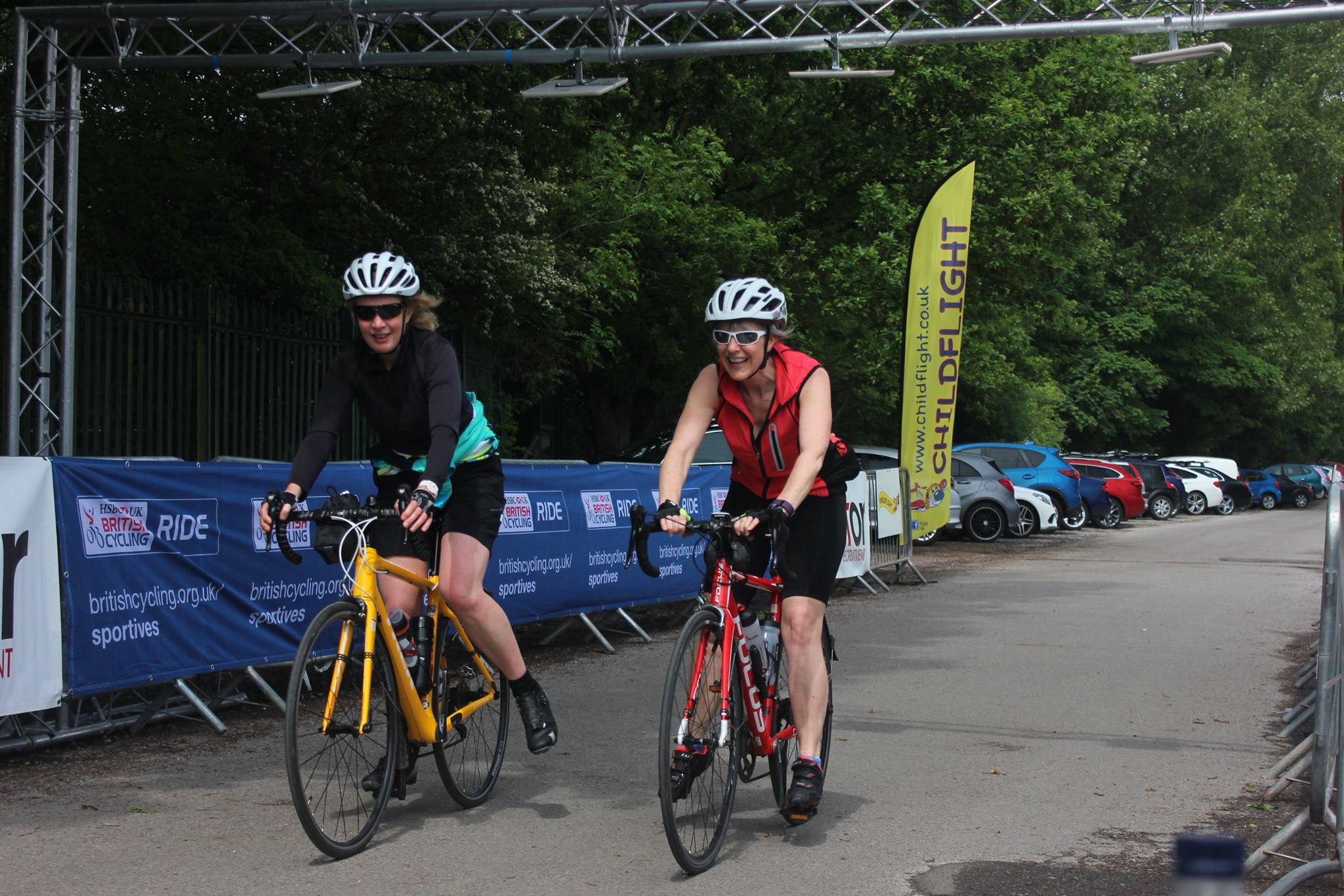 Maire and Andrea still smiling as they cross the Cycle For Amy finish line