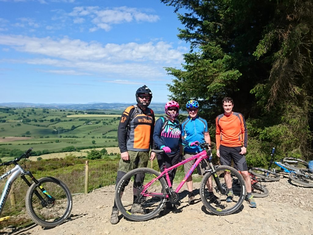 Ian, Kirsty, Ash and Dave enjoying the sun and views from the Red Trail at Llandegla